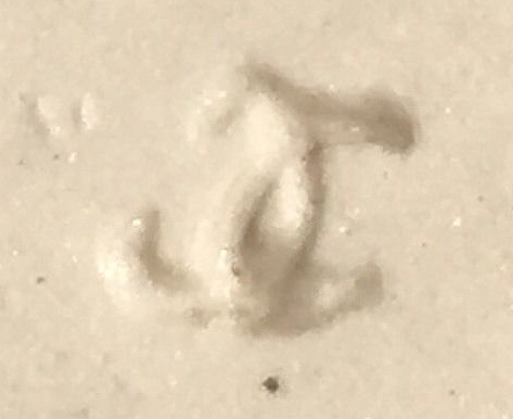 raised overlapping double C mold mark
