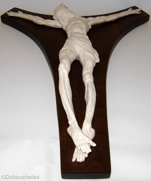 crucifix on wooden cross by Cybis