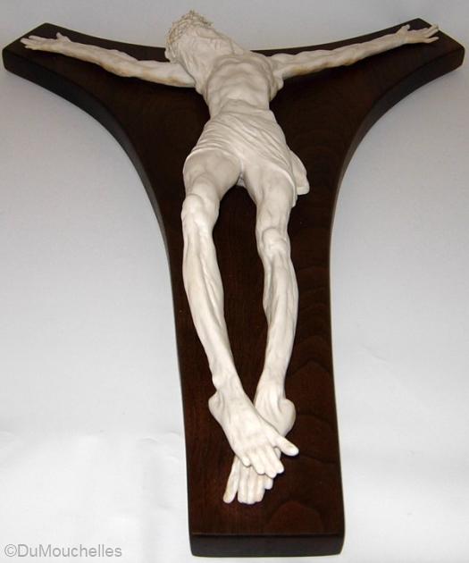 crucifix on wooden cross by Cybis