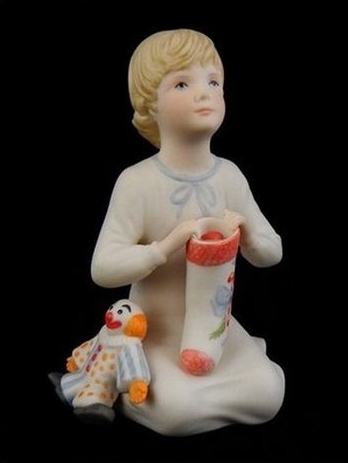 1983 HOLIDAY CHILD with clown and candycane stocking by Cybis