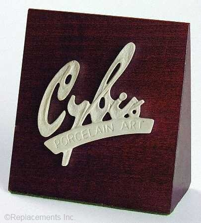 Cybis dealer sign 1960s signature on dark wood