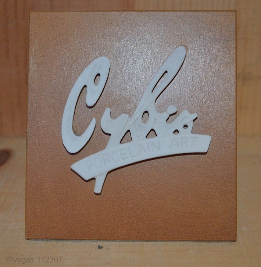 Cybis dealer sign 1960s signature on light wood