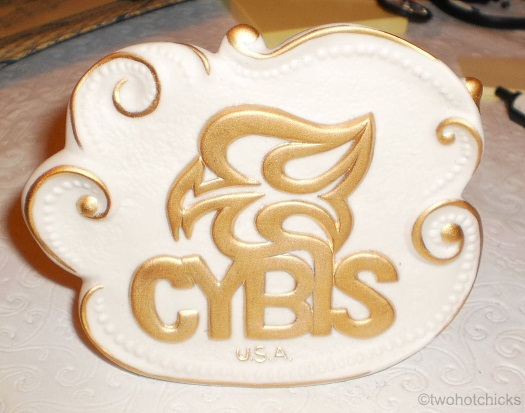 Cybis freeform dealer sign matte gold on white 1990s