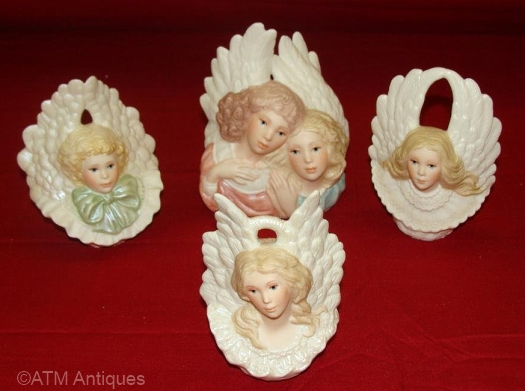 four annual ANGEL ORNAMENTS by Cybis