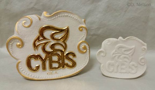 full and mini size Cybis dealer signs