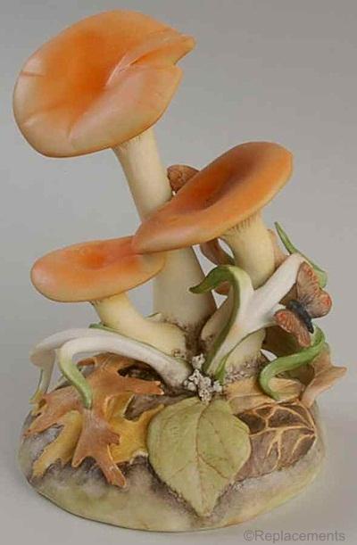 Mushroom Jack O Lantern by Cybis with butterfly on leaf