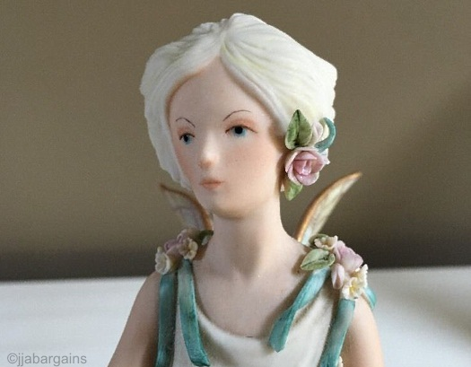 Queen Titania with pink flowers
