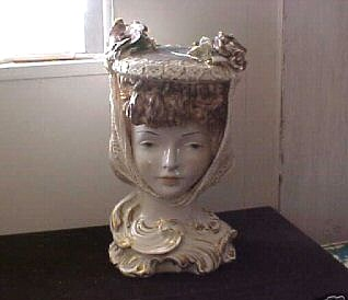 woman with hat bust signed M B Cybis