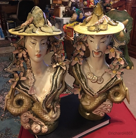 Cordey pair of Asian busts with hats and dragons