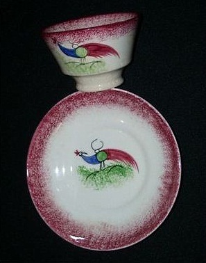 PEAFOWL CUP AND SAUCER red edge spatterware by Cybis 1940s