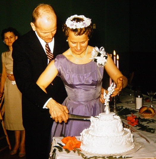 Marylin and Joe Chorlton cutting wedding cake 1957