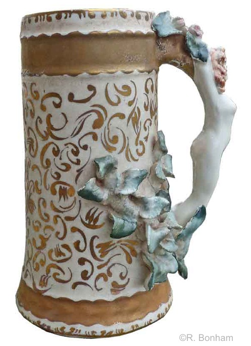 female handle mug with teal leaves and gilt accents by Cybis 1950s view 2